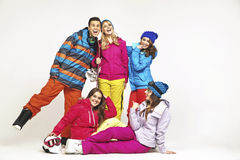 Lucky snowboard guy with four pretty women Royalty Free Stock Photo