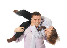 Lucky son sitting on his father stretches Royalty Free Stock Photos