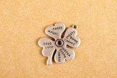 Lucky - Stock Image. Closeup metal clover. that says a lot of desires royalty free stock image