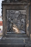 The lucky stone on prague bridge. Czech king Wenceslas follows the confession of the Queen. Part of statue of St John Nepomucen on Charles Bridge in Prague Stock Image