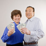 Lucky, wealthy couple holding group of twenties Royalty Free Stock Photos