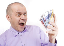Lucky winner. Middle aged business man holding euro money isolated on white Stock Images