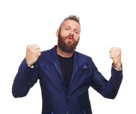 Lucky winner. Bearded man in suit happy of success Royalty Free Stock Images