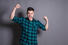 Lucky winner. Emotional man celebrates success Royalty Free Stock Photography
