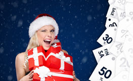 Lucky woman in Christmas cap holds a set of presents Royalty Free Stock Photography