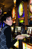Lucky woman holding money in casino Royalty Free Stock Image