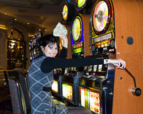Lucky woman holding money in casino Royalty Free Stock Photo