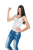 Lucky woman over white background. Successful young female teenager in casual showing yes, isolated on white background Royalty Free Stock Photography