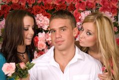 Lucky Young Man. A lucky young man gets the attention of two women Royalty Free Stock Photos