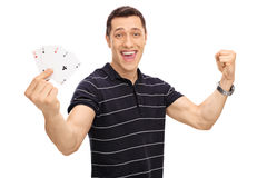Lucky young man holding four aces Royalty Free Stock Images