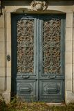 Lucon in the Vendee, France. Chateau d`eau. Historic water works now derelict.Ornate Door stock photography