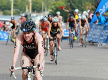 Lucy Hall cycling in the triathlon event Royalty Free Stock Image