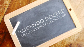 Ludendo docere. Latin phrase, usually translated into English as teaching while having fun Stock Images