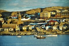 Luderitz, Namibia, Africa. Cityscape of Luderitz at sunset. Luderitz is a harbour town in southwest Namibia. Filtered image, vintage effect applied. Grunge and Royalty Free Stock Photography