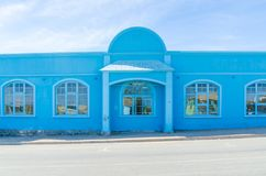 Luderitz, Namibia - July 08 2014: Bright blue German historic colonial house on sunny day Royalty Free Stock Photo