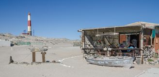 Luderitz, Namibia - July 09 2014: Diaz Cafe and red and white lighthouse at Diaz Point on Luderitz Peninsula.  stock photo