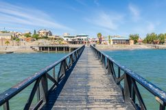 Luderitz, Namibia - July 08 2014: View over Luderitz from wooden jetty at sea on bright sunny day stock photography