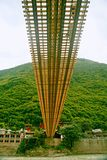 Luding Bridge in Sichuan. Luding Bridge, also known as the tie cable bridge, is located on the Dadu River in Luding County, Sichuan province. After Kangxi Royalty Free Stock Photo