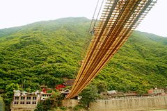 Luding Bridge in Sichuan. Luding Bridge, also known as the tie cable bridge, is located on the Dadu River in Luding County, Sichuan province. After Kangxi Stock Photos