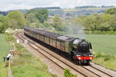 Steam train on excursion special. LUDLOW, UK - MAY 19: The Flying Scotsman makes its return journey to Cardiff having left Shrewsbury with a full load of Royalty Free Stock Photos