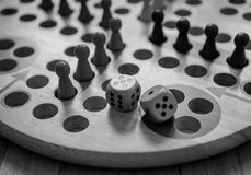 Ludo board family game. Close-up view. Black and white Royalty Free Stock Photo