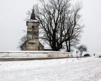 All Saints church in Ludrova village, northern Slovakia. LUDROVA, SK - DECEMBER 31, 2017: All Saints church in Ludrova village, northern Slovakia. This rare stock photo