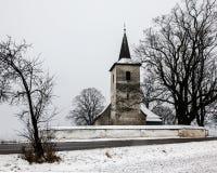 All Saints church in Ludrova village, northern Slovakia. LUDROVA, SK - DECEMBER 31, 2017: All Saints church in Ludrova village, northern Slovakia. This rare royalty free stock image