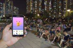 Ludzie bawić się Pokemon w parku Fotografia Royalty Free