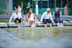 Ludzie biznesu bryzga wodę z ich ciekami Obrazy Royalty Free