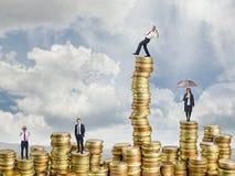 Ludzie biznesu na monecie Obraz Stock