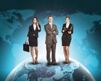 Ludzie biznesu stoi na Ziemskiej powierzchni Zdjęcia Royalty Free