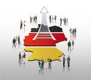 Ludzie biznesu stoi z drabinową strzała i niemiec zaznaczają Zdjęcia Stock