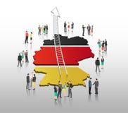 Ludzie biznesu stoi z drabinową strzała i niemiec zaznaczają Obraz Stock