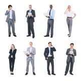 Ludzie Biznesu Trzyma Cyfrowych przyrząda obraz royalty free