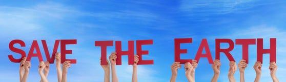 Ludzie Trzyma Save ziemia w niebie Zdjęcie Royalty Free