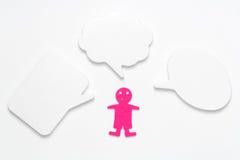 Ludzka postać w menchiach z trzy mowa bąblami Obrazy Stock