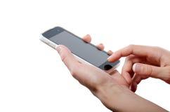 Ludzka ręka dotyka mądrze telefonu ekran odizolowywającego na białym tle Zdjęcia Stock