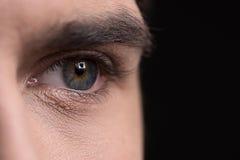 Ludzki oko. Zakończenie ludzki oko na czerni Zdjęcia Stock