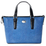 Вlue female leather bag made of reptile skin / isolated on whit Stock Photo