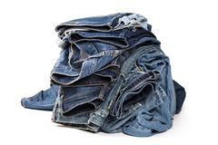 Lue jeans som isoleras på vit bakgrund royaltyfri foto
