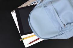 Lue school bag with supplies royalty free stock image