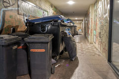 Luebeck, Schleswig-Holstein, Germany, August 17, 2016, Waste container and garbage can with sleeping homeless people at a back ent Stock Photos