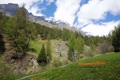 Luekerbad Switzerland Mountain sky  wood bench Royalty Free Stock Images