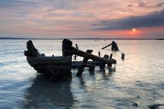 Lueur de coucher du soleil de l'épave de côte Photo libre de droits