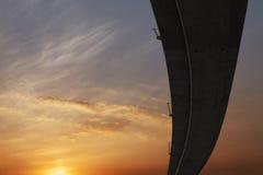 Lueur et route de coucher du soleil Photo stock