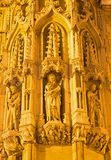 Lueven - Detail of gothic town hall with the statue of saint Stock Image