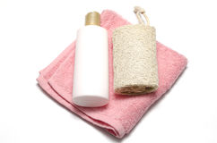 Lufa y toalla del jabón líquido Imagenes de archivo
