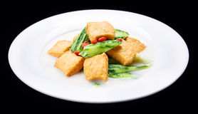 Luffa boiled tofu, Chinese traditional cuisine isolated on black background Stock Photography