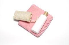 Luffa et serviette de savon liquide photo stock