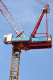 Luffing jib tower crane soars into blue sky Stock Images